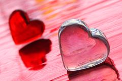Love Hearts. Valentine hearts on the red background - the symbols of love Stock Photo