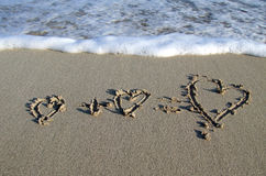 Love hearts. On the beach stock images