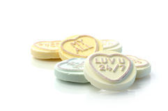 Love Hearts. Studio macro of assorted Love Heart candies depicting classic Valentine messages of love and romance. Copy space stock image