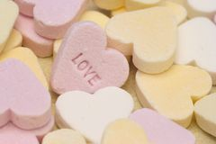 Love Hearts. Close up of pastel colour Love Heart sweets stock images