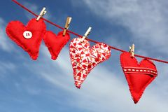 Love hearts on clothes line Stock Photos