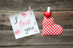 Love hearts hanging on rope on the grey wooden background Stock Photography