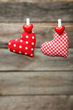 Love hearts hanging on rope on a grey wooden background Stock Images