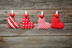 Love hearts hanging on rope on a grey wooden background Royalty Free Stock Image
