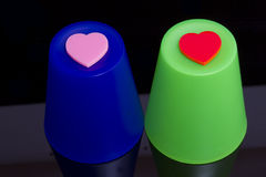 Love hearts on plastic cups Royalty Free Stock Photo