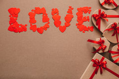 Love from hearts and Stylish gifts with red ribbons. Stock Photo