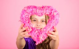 Love holiday decor. Love concept. Girl cute child show heart shaped decor. Symbol of love. Kid adorable girl with long. Hair happy face show heart to you. Look royalty free stock photos