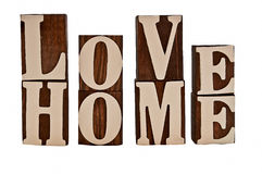 Love home. Isolated over white rough edged wooden blocks spelling out love home (intentionally grungy stock image