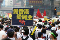 We love Hong Kong, we love democracy. The 1 July 2004 Hong Kong March have been held as a channel to demand for democracy, universal suffrage, rights of royalty free stock photos