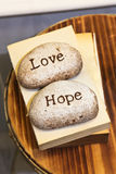 Love and Hope engraved on stones Stock Photo
