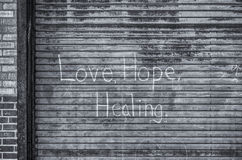Love, Hope, Healing. Overheard Door that Graffiti displays Hope, Love, Healing royalty free stock image