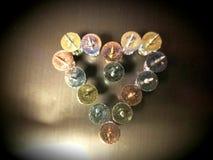 Love Hurts. Turned up thumb tacks shaped like a heart royalty free stock photography