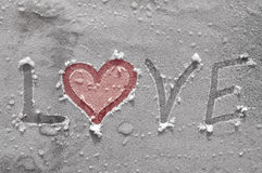 Love on ice. View of word love written on ice Royalty Free Stock Image