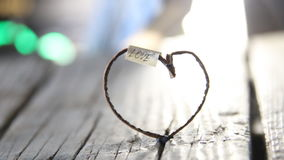 Love idea - inscription and heart, Valentines Day idea. Love inscription and heart on vintage old wooden table stock video footage