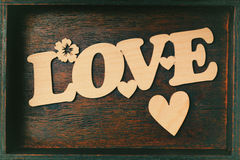 Love inscription. Carved wood, Wooden heart. Love letter in a box Royalty Free Stock Photos
