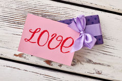 Love inscription on paper. Royalty Free Stock Photo