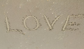 Love,  inscription on the sand, travel Stock Images