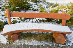 Love inscription on a wooden bench Royalty Free Stock Photography