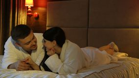 Love intimate relationship tender communication. Love couple. intimate relationship. tender communication. man and woman lying in the bedroom in bathrobes stock video