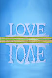love and inverted reflection in water Royalty Free Stock Photography