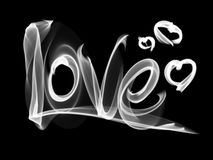 Love isolated word lettering and heart written with fire flame or smoke on black background.  Stock Images