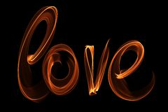 Love isolated word lettering written with fire flame or smoke on black background.  Stock Image