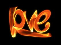 Love isolated word lettering written with fire flame or smoke on black background.  Stock Images