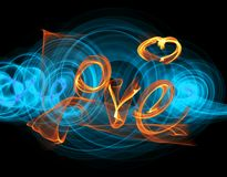 Love isolated word lettering written with fire flame or smoke on black background.  Stock Photography