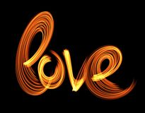 Love isolated word lettering written with fire flame or smoke on black background.  Royalty Free Stock Images