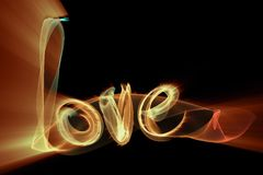 Love isolated word lettering written with fire flame or smoke on black background.  Royalty Free Stock Photo
