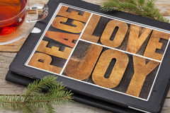 Love, joy and peace on digital tablet Royalty Free Stock Photo