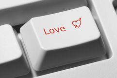 Love key. Closeup of keyboard key with text Love and red heart Stock Photography