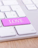 Love key. A keyboard with the letters 'Love' on a pink key royalty free stock photo