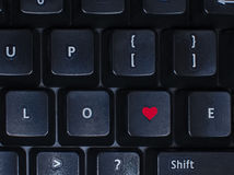 Love on keyboard. Special keys on keyboard prepared for love stock photography