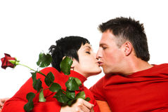 Love kiss. Young couple is having a date. They are kissing each other Stock Photography