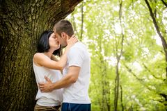 Love - kiss in forest Stock Image