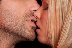 Love kiss of young sexy heterosexual sensual couple Stock Photos
