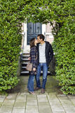 Love kissing couple embracing outdoor looking happy. Portrait of love kissing couple embracing outdoor looking happy Royalty Free Stock Images