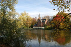 The love lake in Bruges. Minnewater — the love lake in the park of the same name. The water level is regulated to this day by old mechanics stock images
