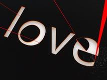 Love laser. Valentine's Day celebration concept: red laser burns love Royalty Free Stock Images