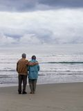 Love that Lasts. Elderly couple looking out over the ocean Stock Photos