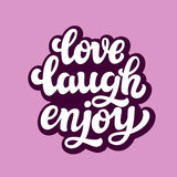 Love laugh enjoy. Typography text Stock Photography