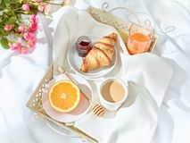 The Love lconcept on table with breakfast. The Love concept on table with breakfast, coffee, cake, flowers royalty free stock image