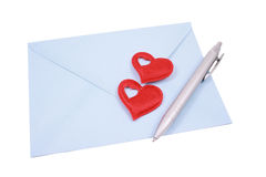 Love letter. Blue envelope with red hearta and pen isolated on white royalty free stock images