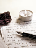 A love letter. Written under a light candles Stock Photo