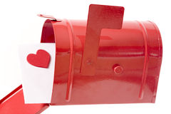Love letter. In a red mailbox isolated on white royalty free stock photo