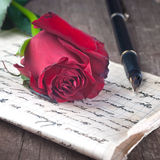 Love letter. And rose close up Stock Photo