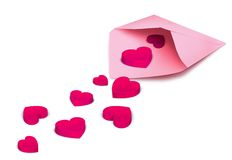 Love letter. Pink hearts falling out of an pink envelope Royalty Free Stock Images