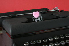 Love Letter. An old-fashioned typewriter delivers a whimsical, romantic, timeless love letter royalty free stock image