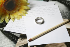Love letter. Ring and flower Stock Image
